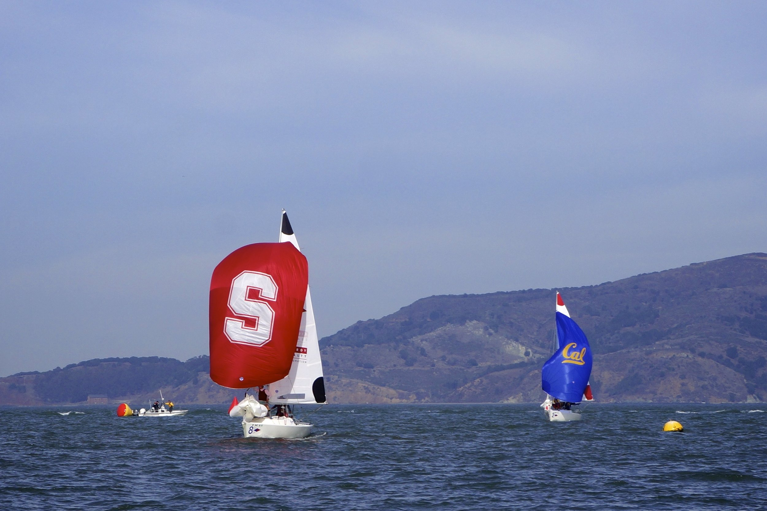 Stanford pulls ahead of UC Berkeley in a one-on-one match race, during the Big Sail on Thursday.