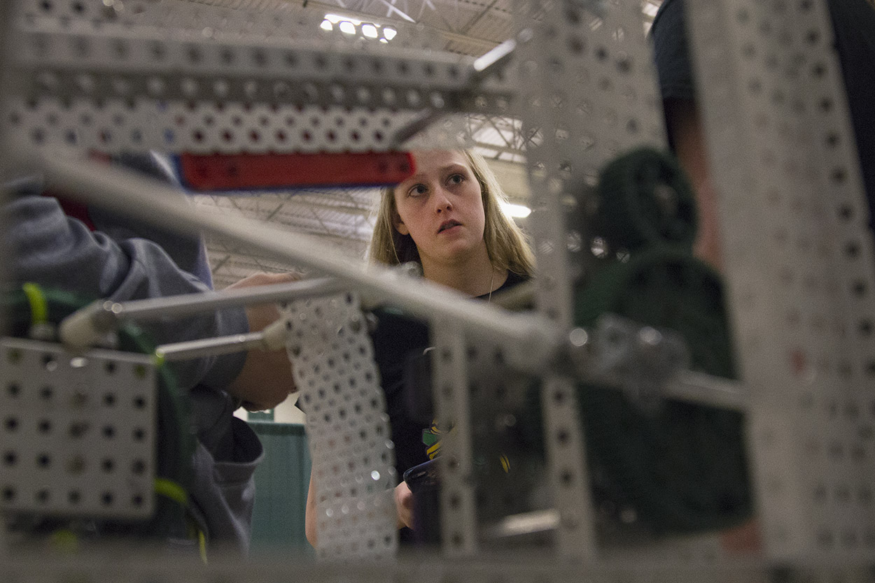 Kaitlyn De Kan, 17, talks with her teammates during the VEX Missouri State Robotics Championship in Rolla on Saturday. The team's robot sits on the table in front of them as they discuss strategy.
