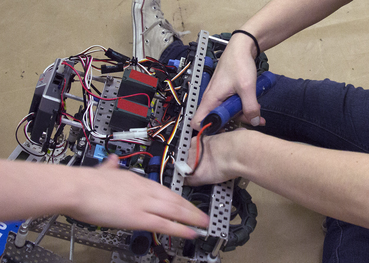 The Cyber Pirates make repairs to their robot before the start of their competition during the VEX Missouri State Robotics Championship in Rolla on Saturday.
