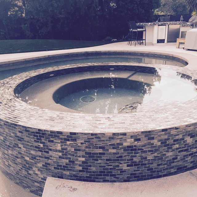 Glass tile perimeter overflow spa