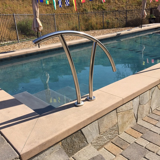 Deco pool entry hand rail
