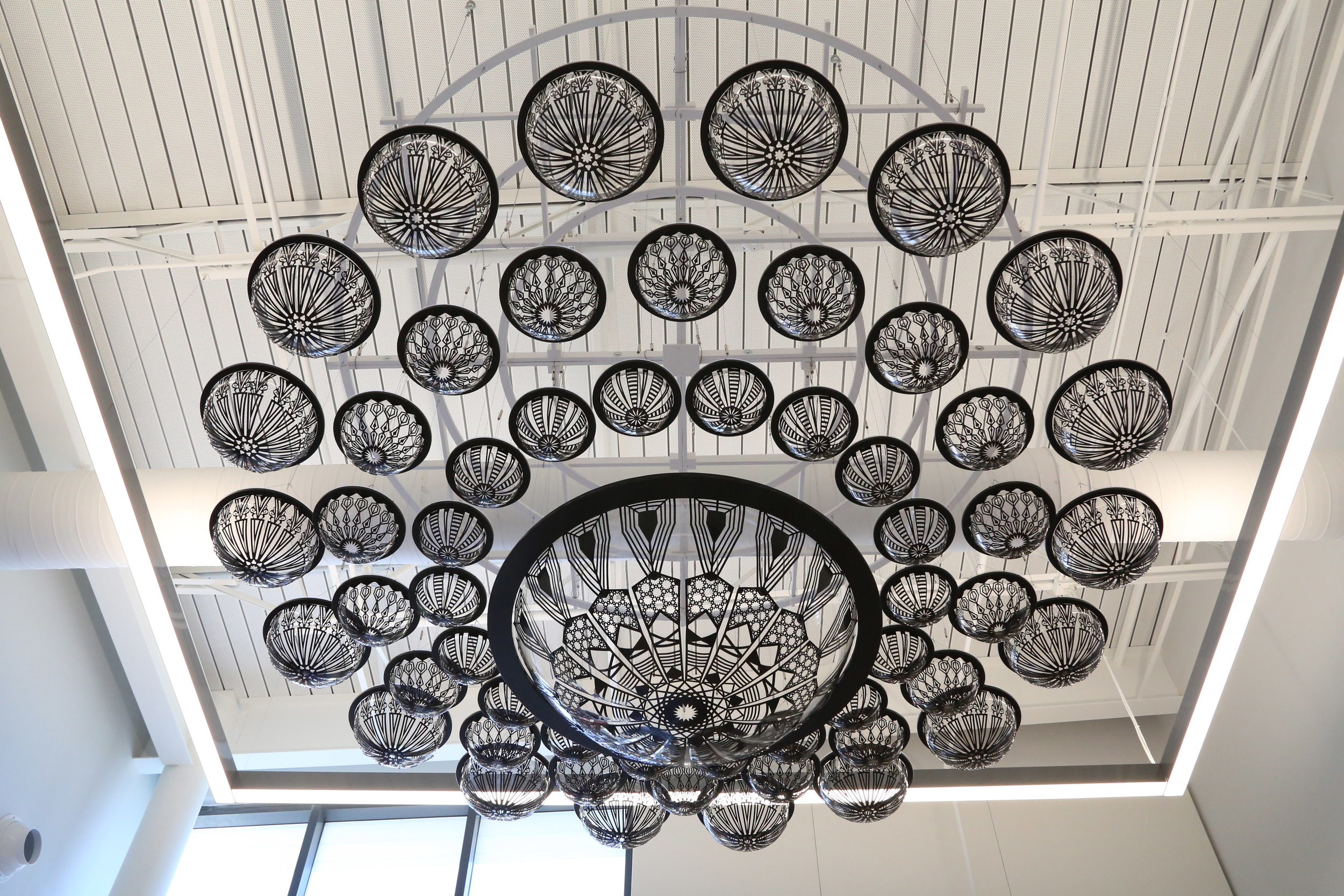 The Dayton Metropolitan Library ceiling sculpture by Virginia Kistler. Laser cutting by WE LASERS.