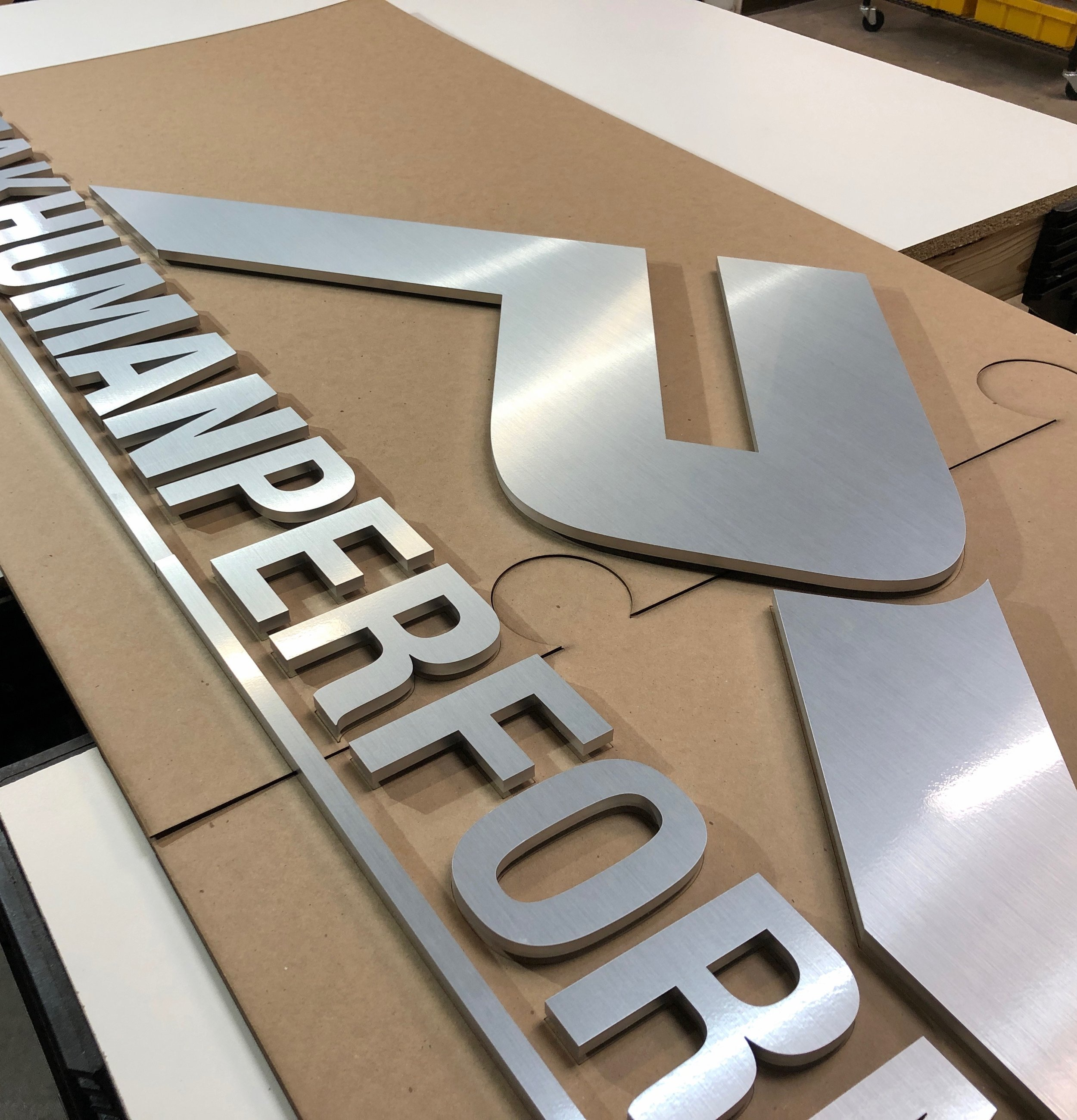 laser cut brushed aluminum sign.