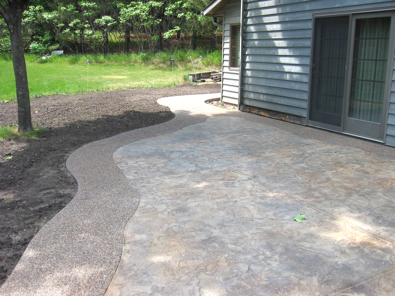 Stamped and Colored Concrete with an Exposed Aggregate Border