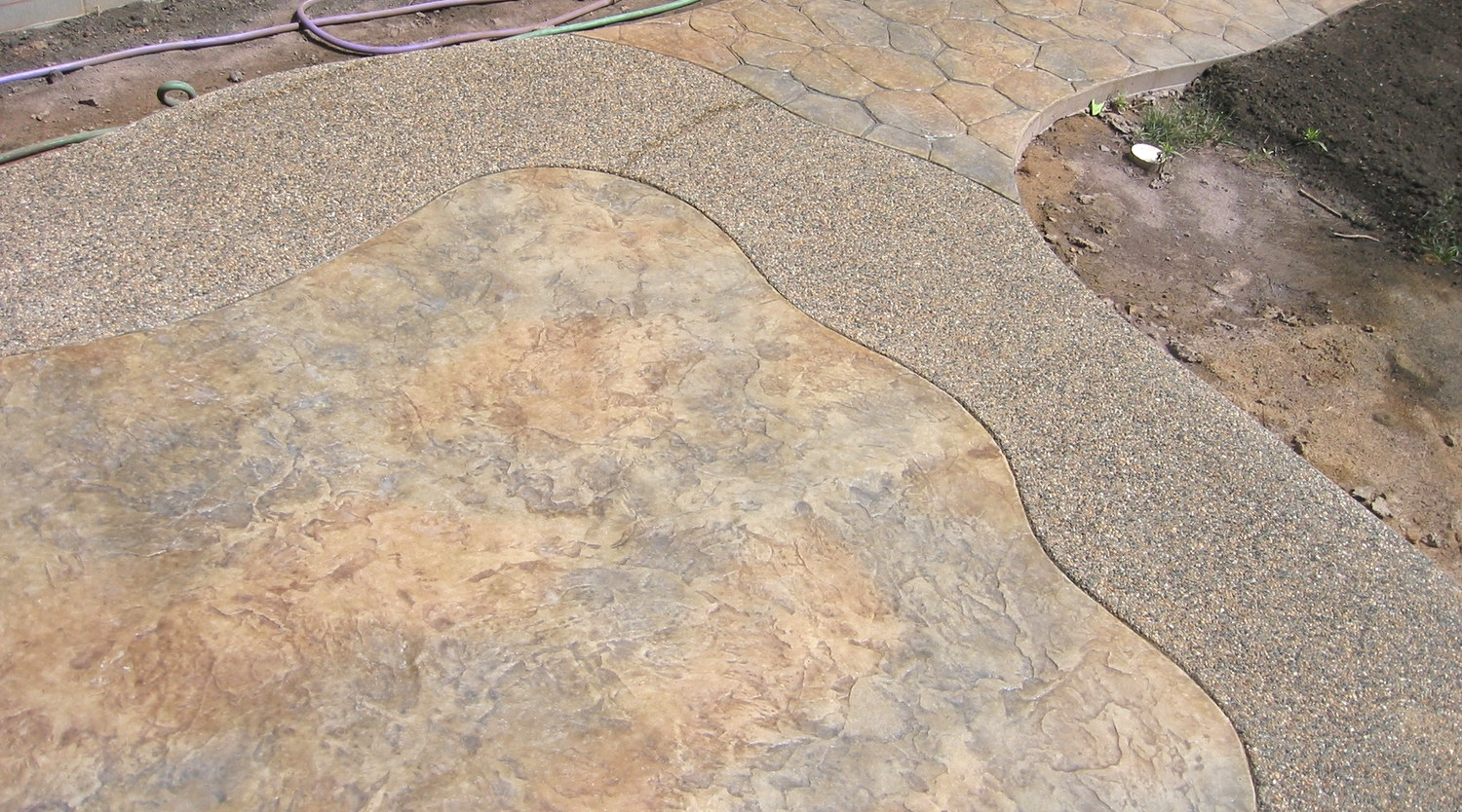 Stamped and Colored Concrete with Exposed Aggregate Border