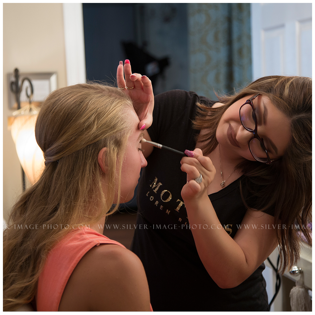 Makeup artist Sheila getting Shea ready for her session.