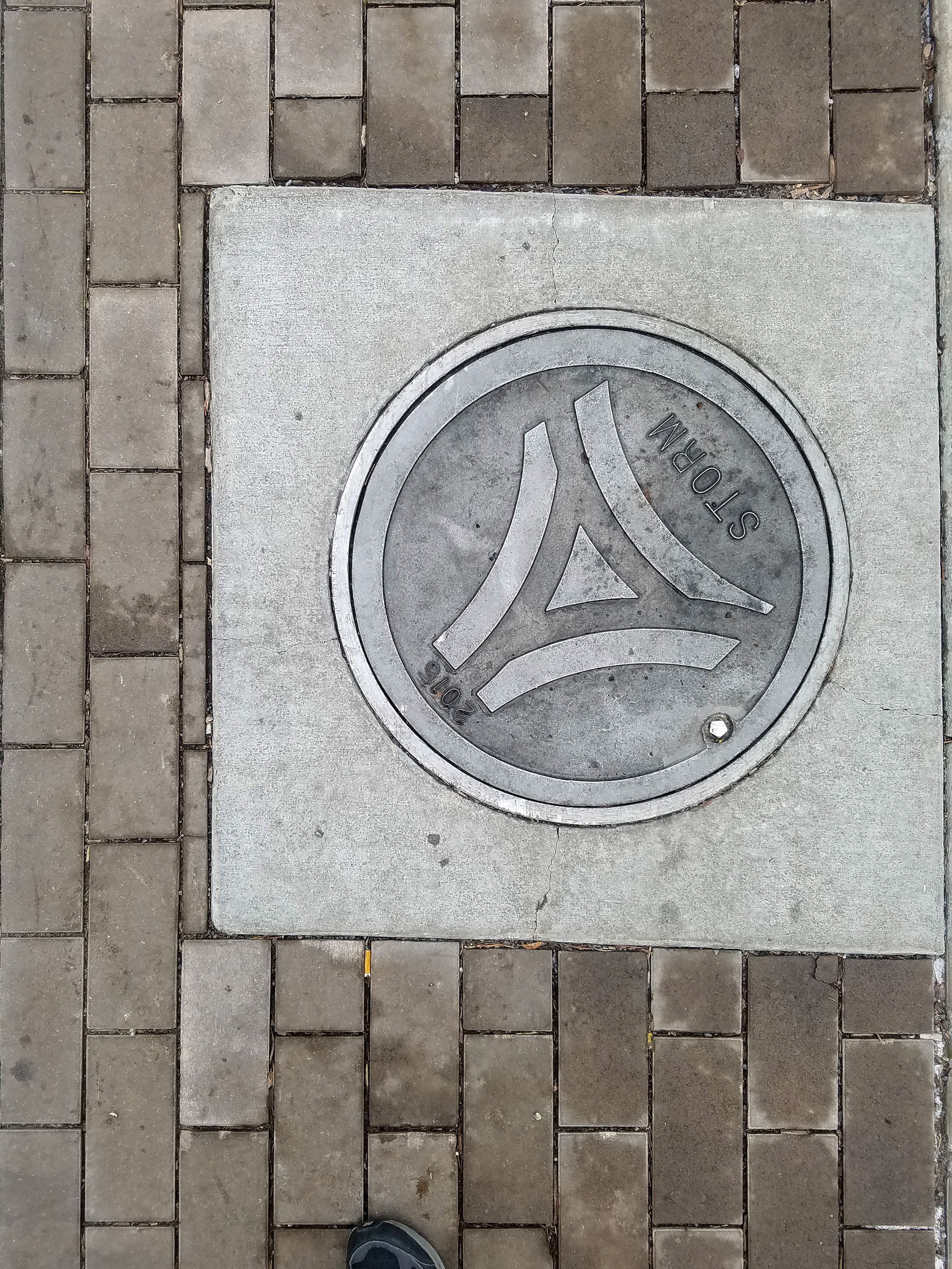 Auraria-branded manhole covers can be found disrupting the pattern of the bricks every once in a while. Bricks around the concrete margin are cut to interestingly small sizes.