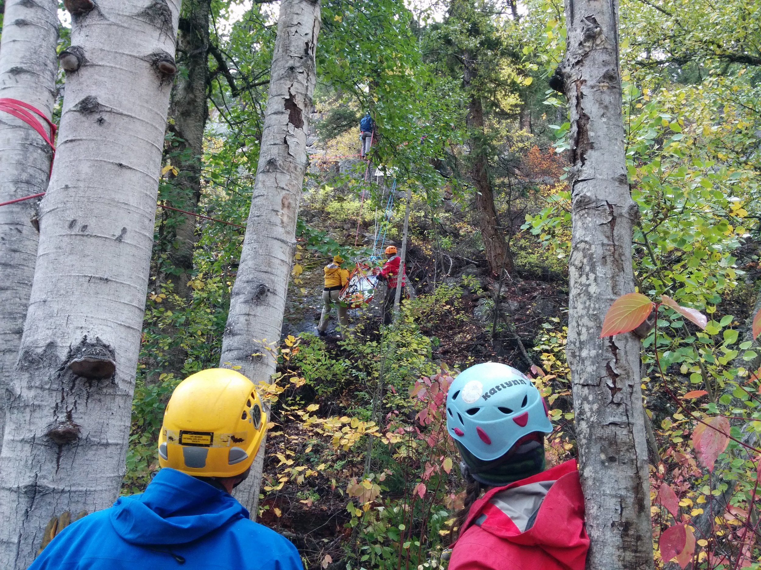 Raising rescuers and stretcher to top.