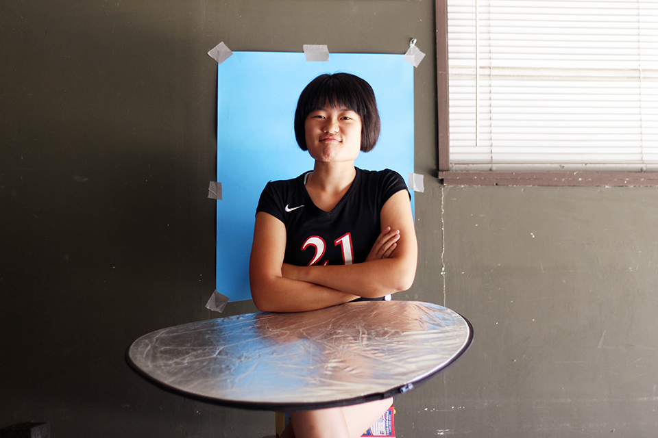 My first idea was a yearbook mug-style collage shoot. Here is our star holding her own reflector in our very DIY garage studio. We work with what we've got!