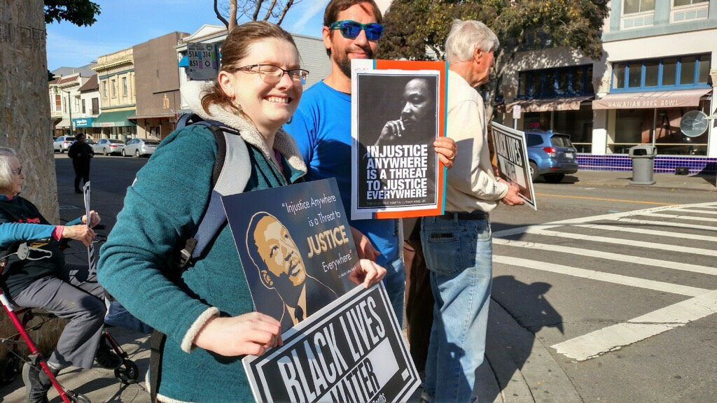 Alamedan's participating in a vigil on MLK Day.