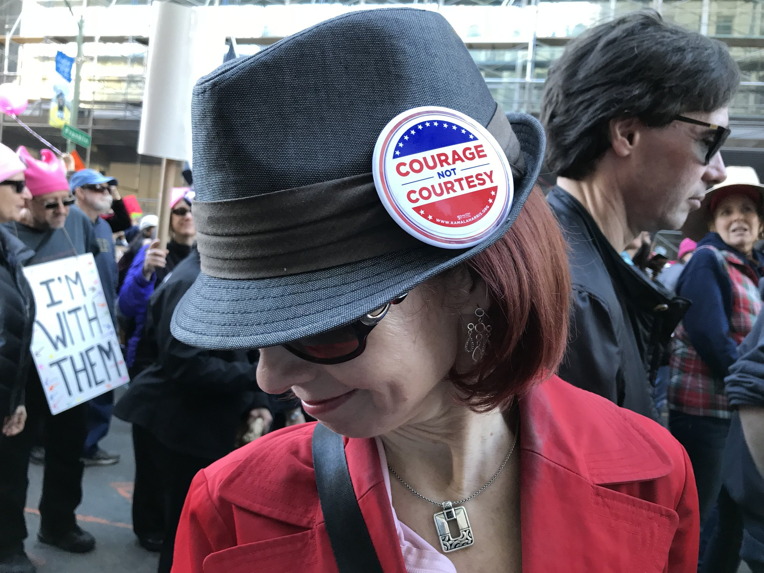 CADC Member Kim poses with the Kamala Harris campaign button she's chosen to wear to the Women's March. Photo Credit: Julie Casey
