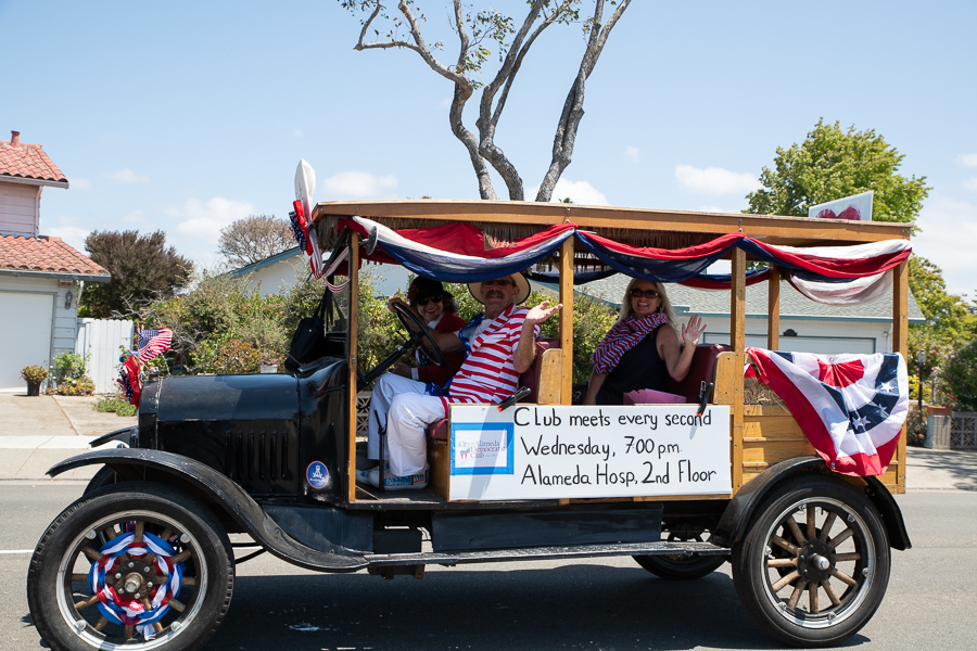 Club Co-President Gabrielle Dolphin and members Alan Pryor and Michele Pryor ride in the 4th of July parade. [Photo Credit: Julie Casey]
