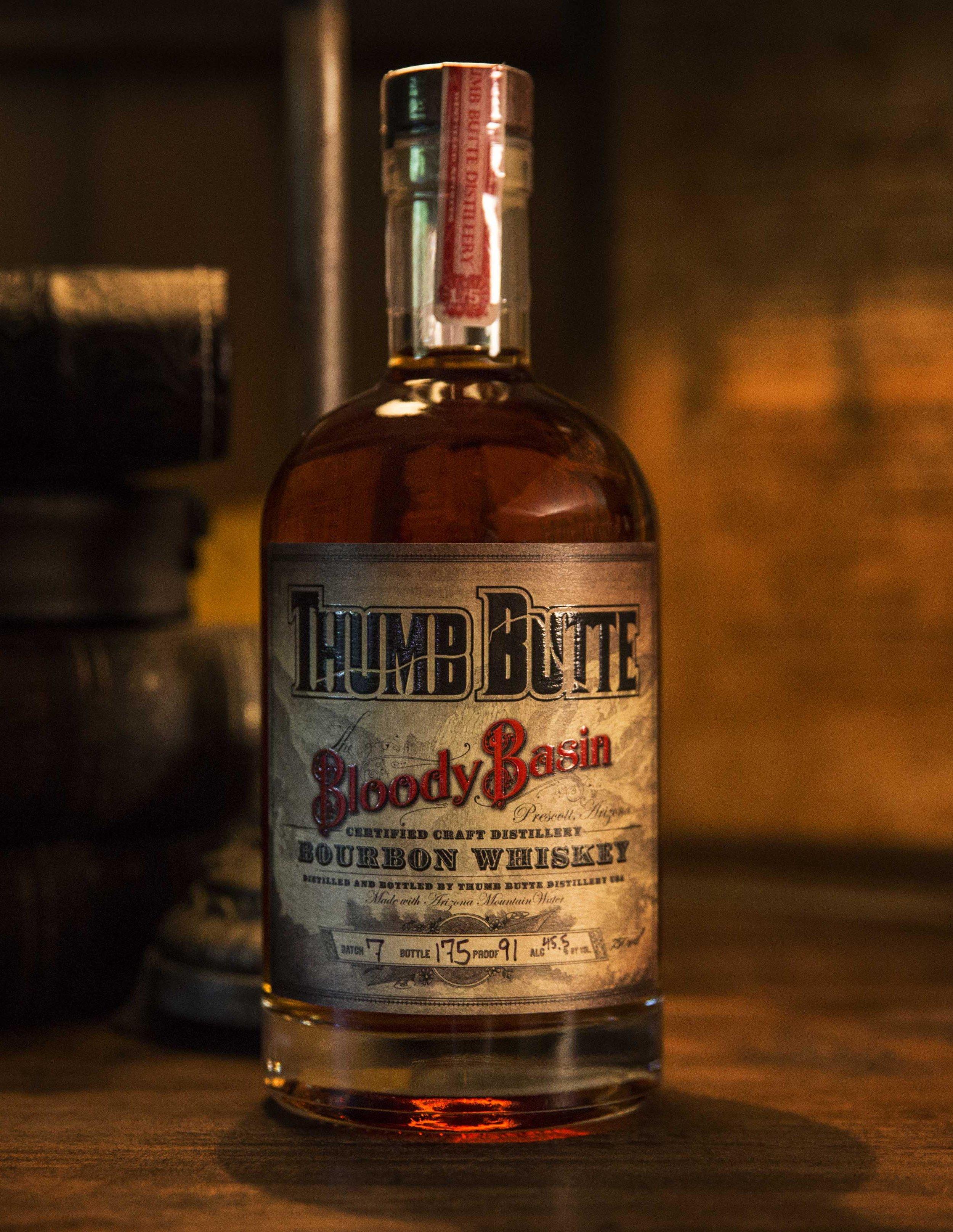 Bottle label design for Thumb Butte Distillery Blood Basin Bourbon Whiskey