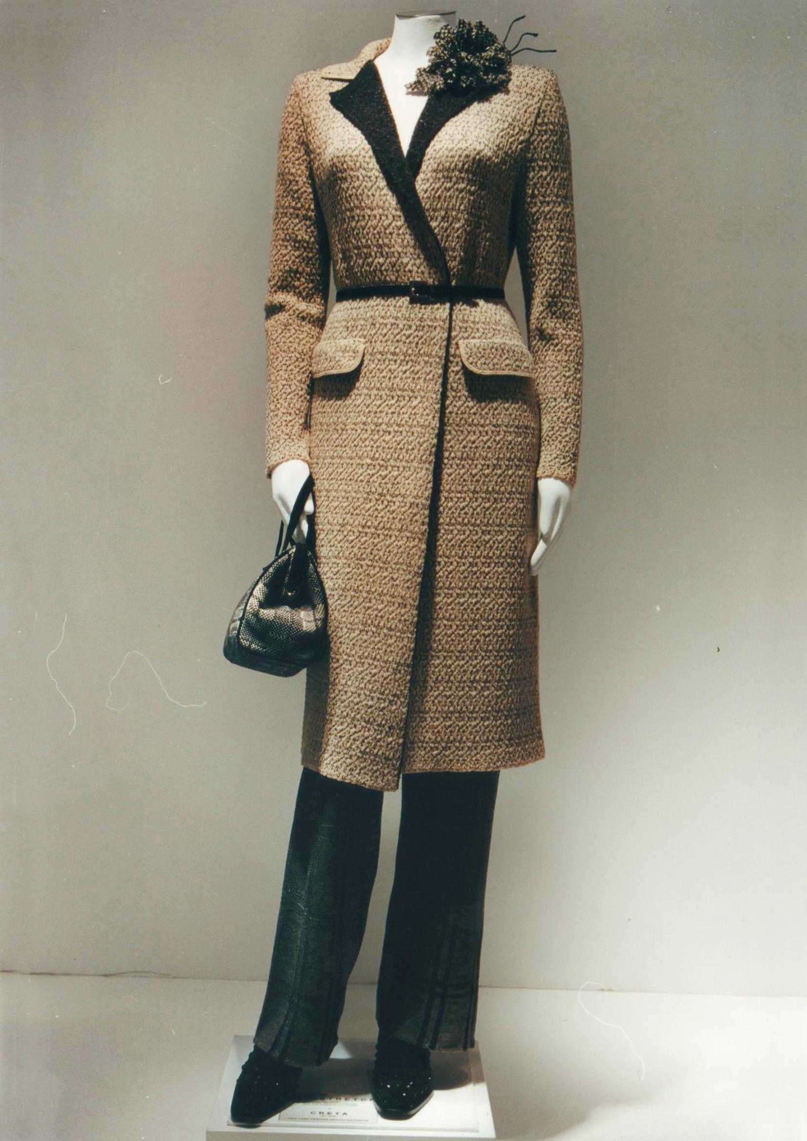 Cappotto double con lavorazione goffrata e punti trattenuti su finezza 12