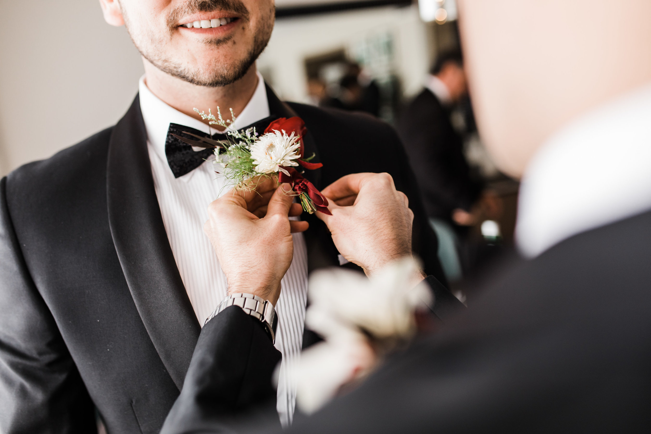 Groom buttonhole - For grooms wanting to match your partner with a floral touch, we recommend a buttonhole that you'd pin on your chest. Usually this goes on the lapel of a jacket.