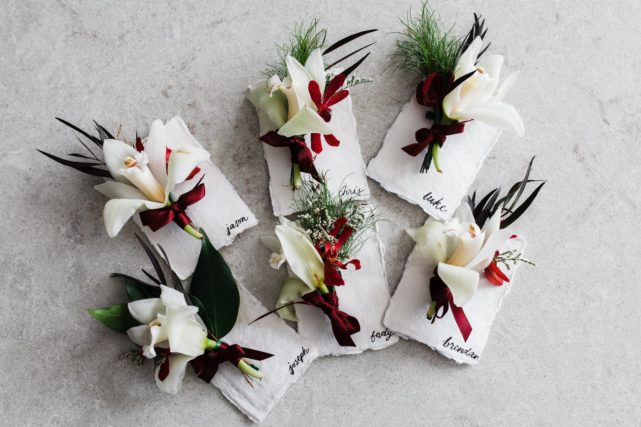 Groomsmen buttonholes - Best men and/or any groomsmen usually have a similarly matching buttonhole pinned on their chest too. Like the bridesmaids, it is normally slightly smaller and simpler.
