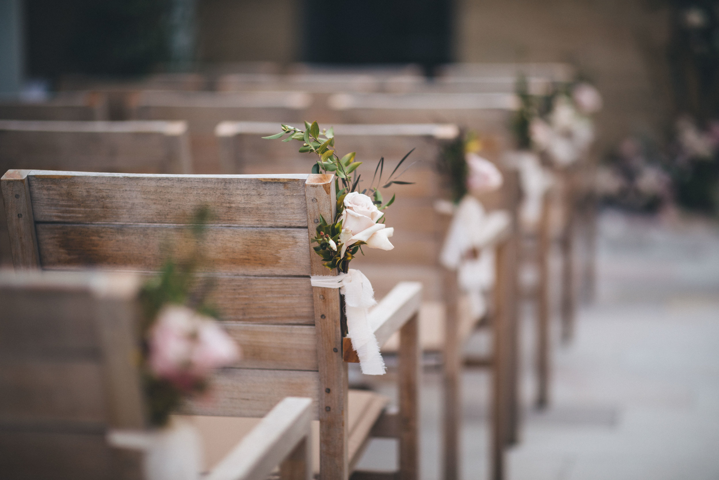 Chair / aisle decor - Add a touch of something pretty to the aisle edge, whether that be the chairs, church pews or the aisle floor area. Rose petals, floor floral arrangements and/or floral chair ties provide a nice touch!