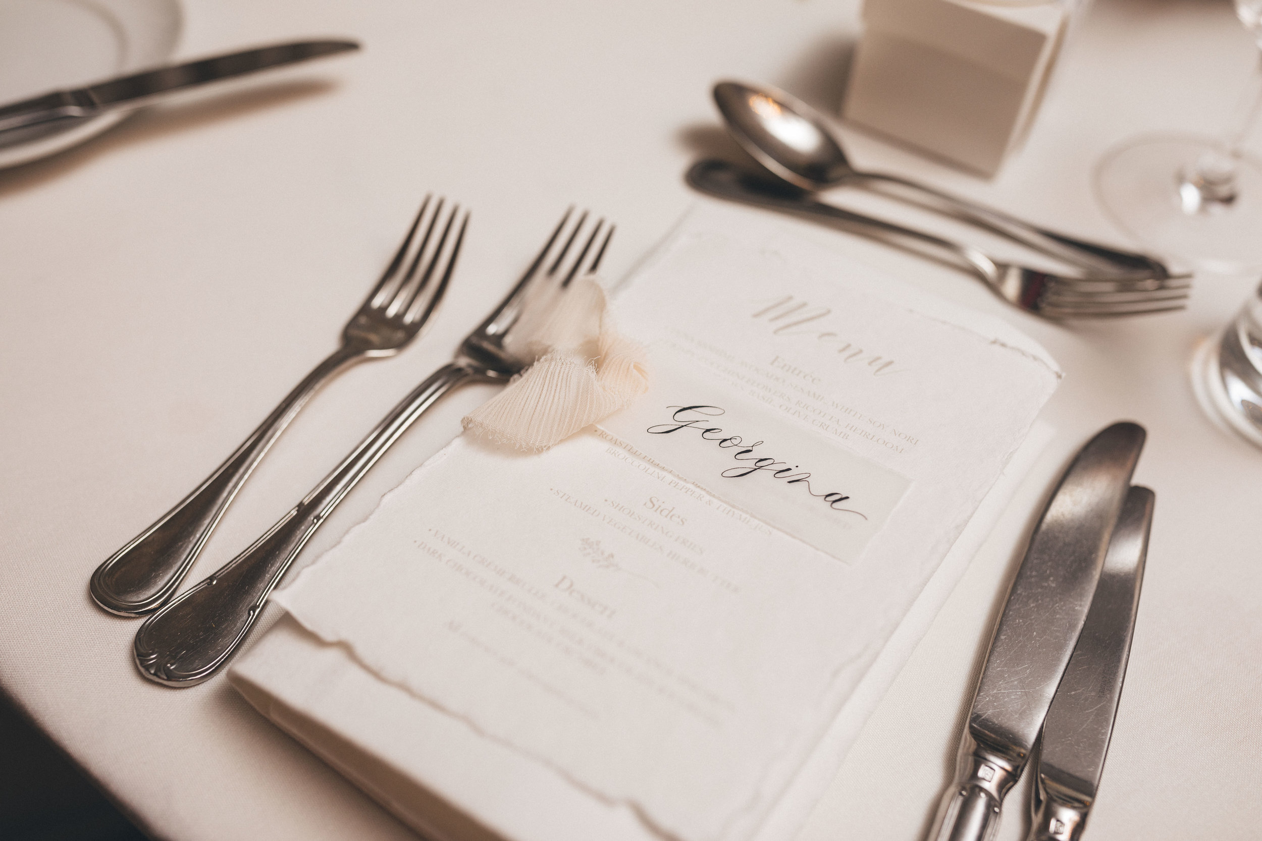 Menus & name place cards - To further create a cohesive look throughout the reception, having custom made name place cards and/or menus can create a personalised feel for each guest.