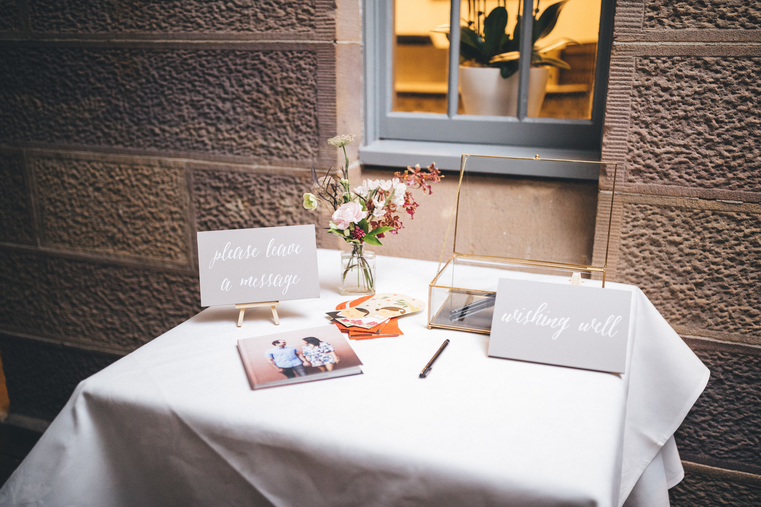 Wishing well / gift table - It's common to have a space set aside for guests to provide gifts, a guest book and/or a wishing well. Add some signage and a touch of decor to pretty it up and draw guests towards it.