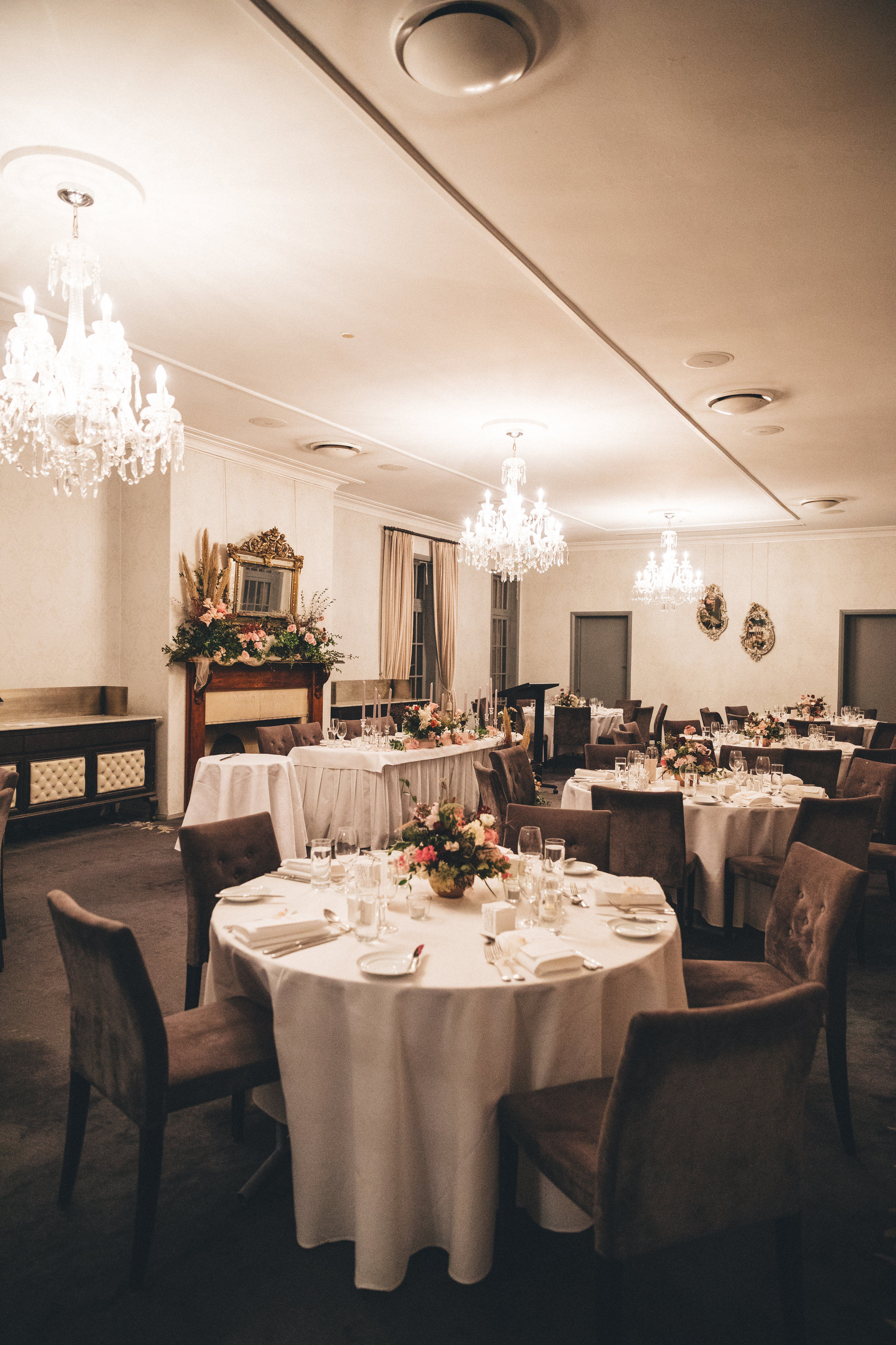 Lighting - Consider adding chandeliers, fairy lights or other types of lighting to further brighten up a moody space and create a touch of grandeur. Make sure to check with the venue to see what they allow.