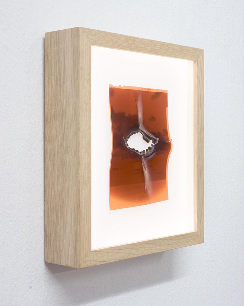 "Side view  Apparition III  2/8  Original 4x5"" color negative in backlit frame  Burnt  10,1 x 12,7 cm  2011/2018"
