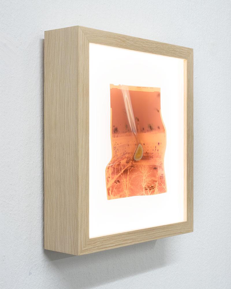 "Side view  Apparition VI  AP  Original 4x5"" color negative in backlit frame  Microwaved for 8 minutes  10,1 x 12,7 cm  2009/2018"