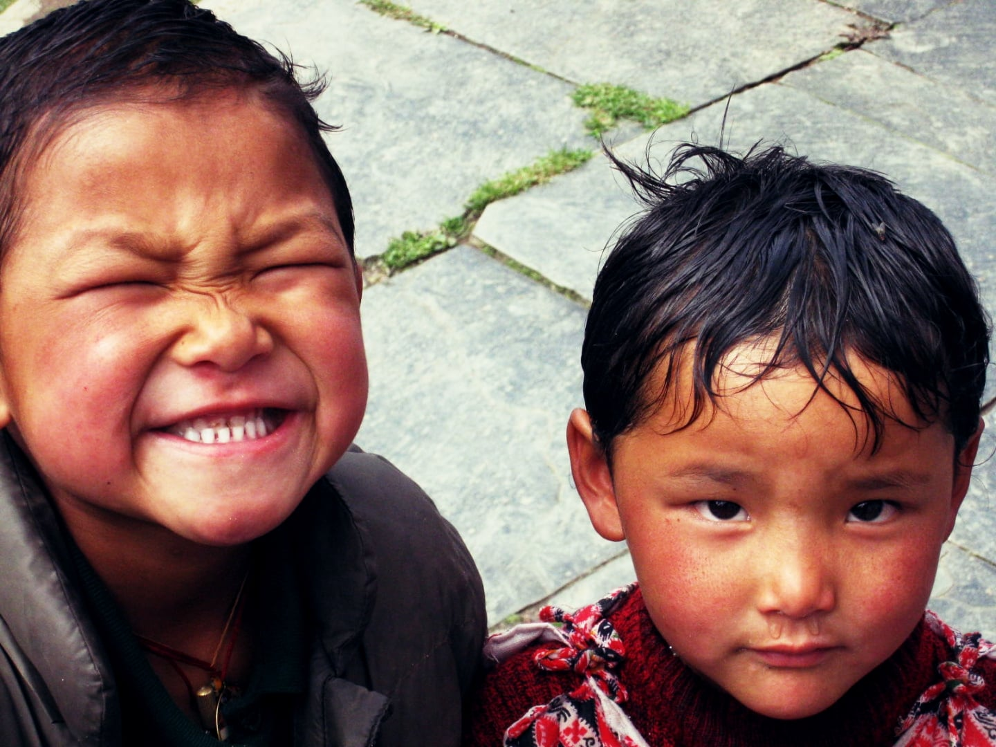 Sherpa children smiling to the camera on the Everest trail.