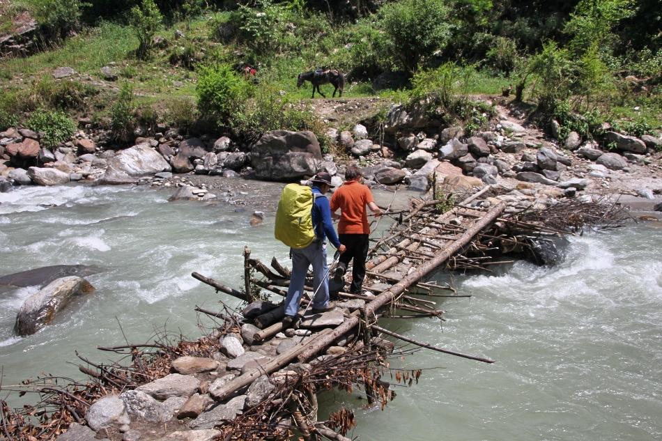 Crossing a bridge during Langtang Valley trek