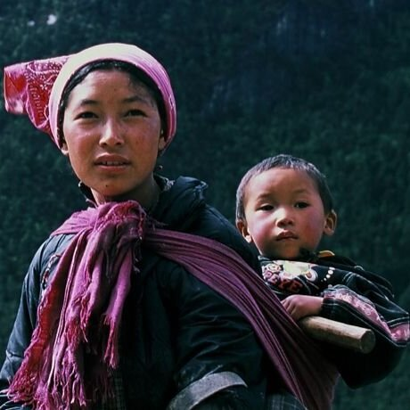 Hyolmo Sherpa woman carrying her baby on her back