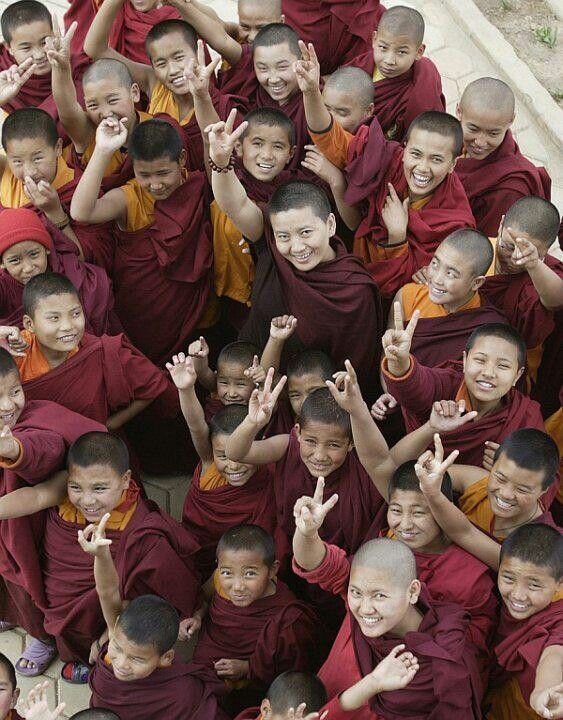 little monks and nuns posing for the camera