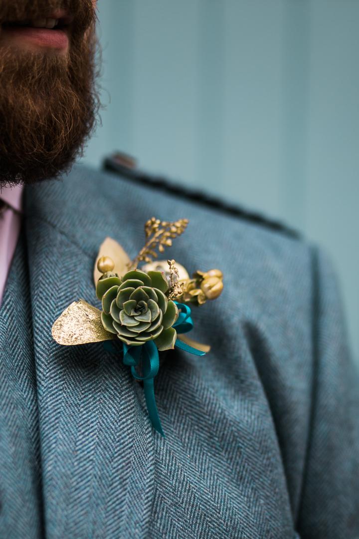Golden succulent buttonhole