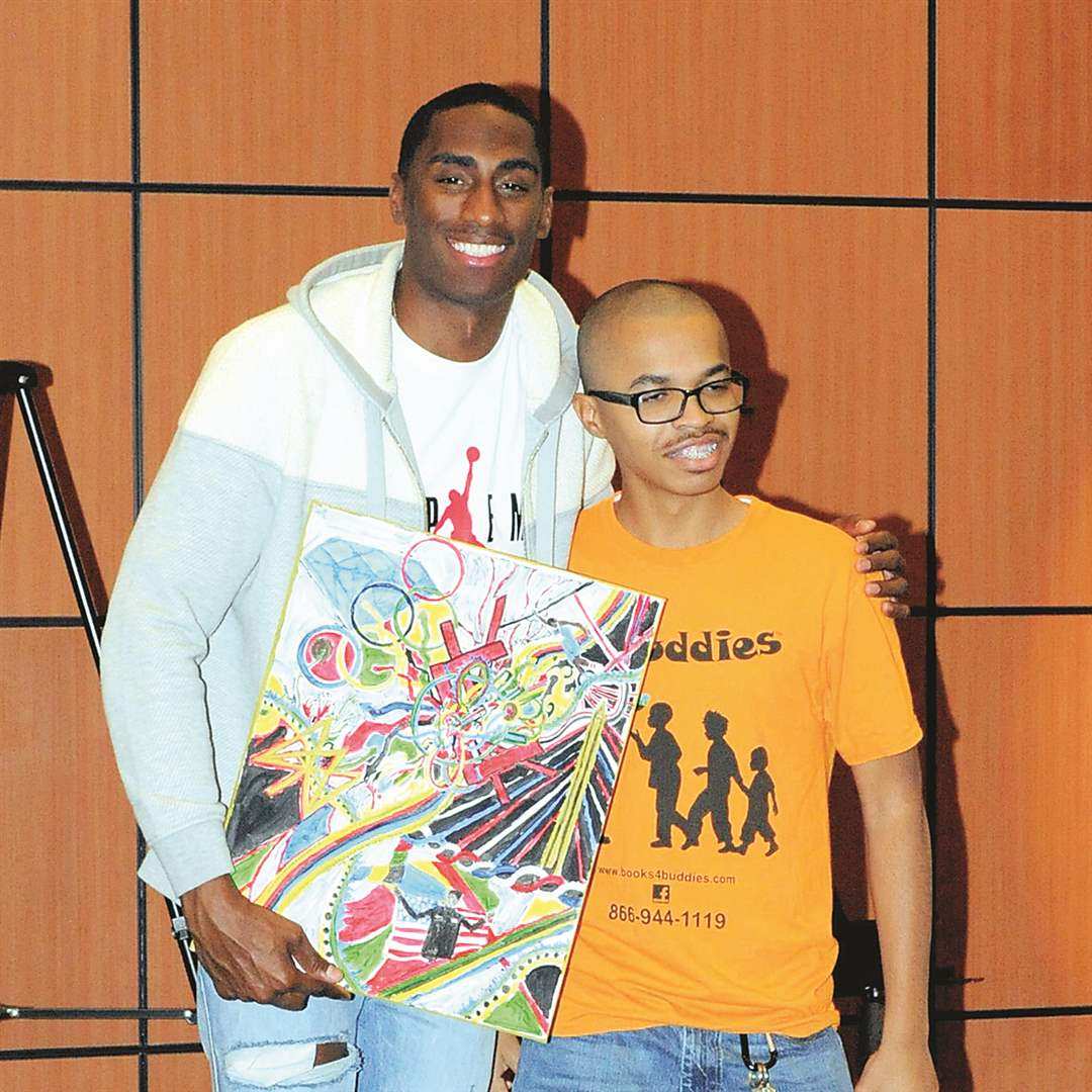 Erik Kynard, Jr. and Cheran Lyle at the Books 4 Buddies event in the McMaster Center at the Toledo-Lucas County Public Library.