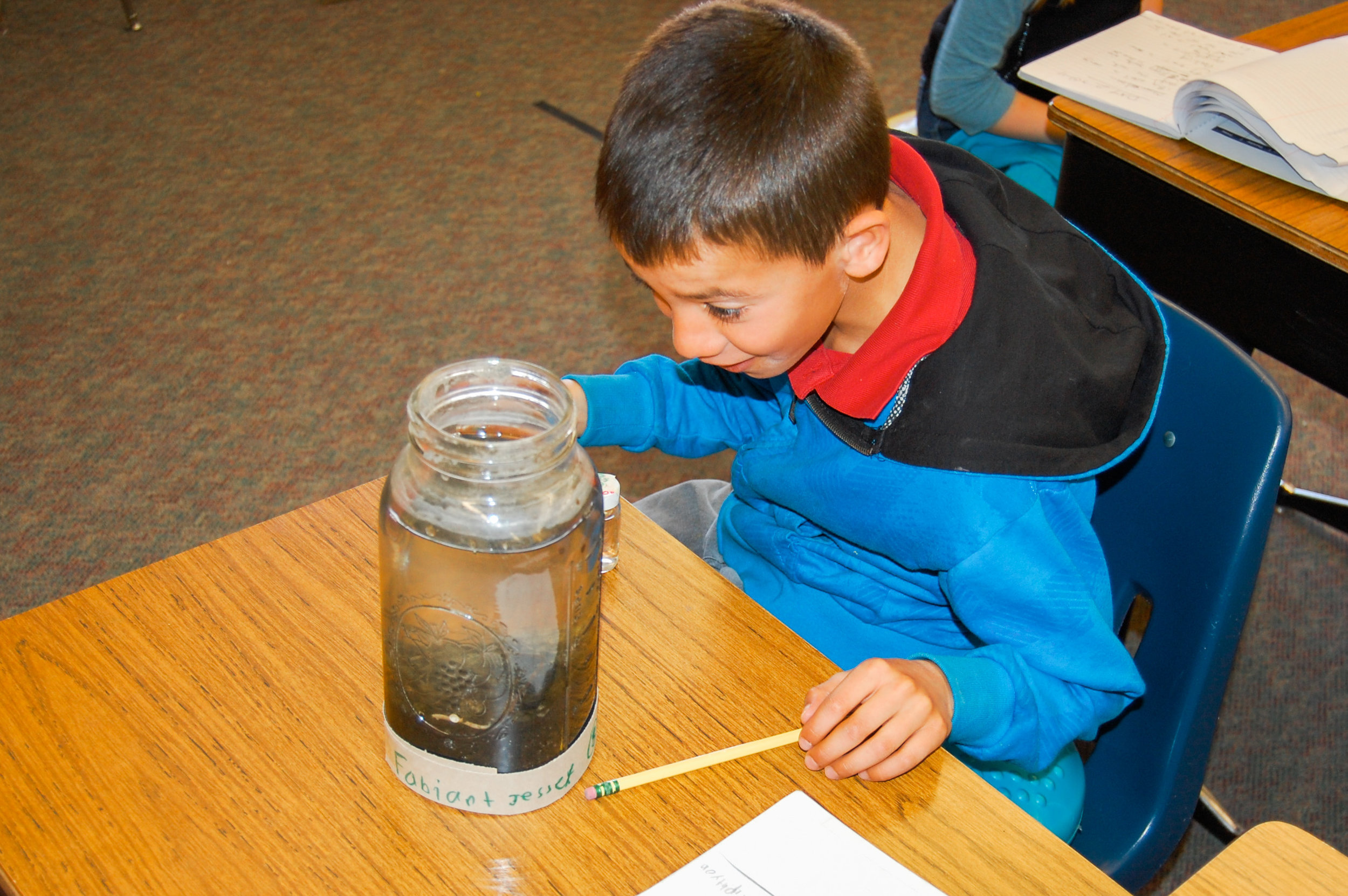 This expression says it all! Students are amazed to watch a pond ecosystem develop in a jar. Hands-on, content-rich and fun.....how education should be!