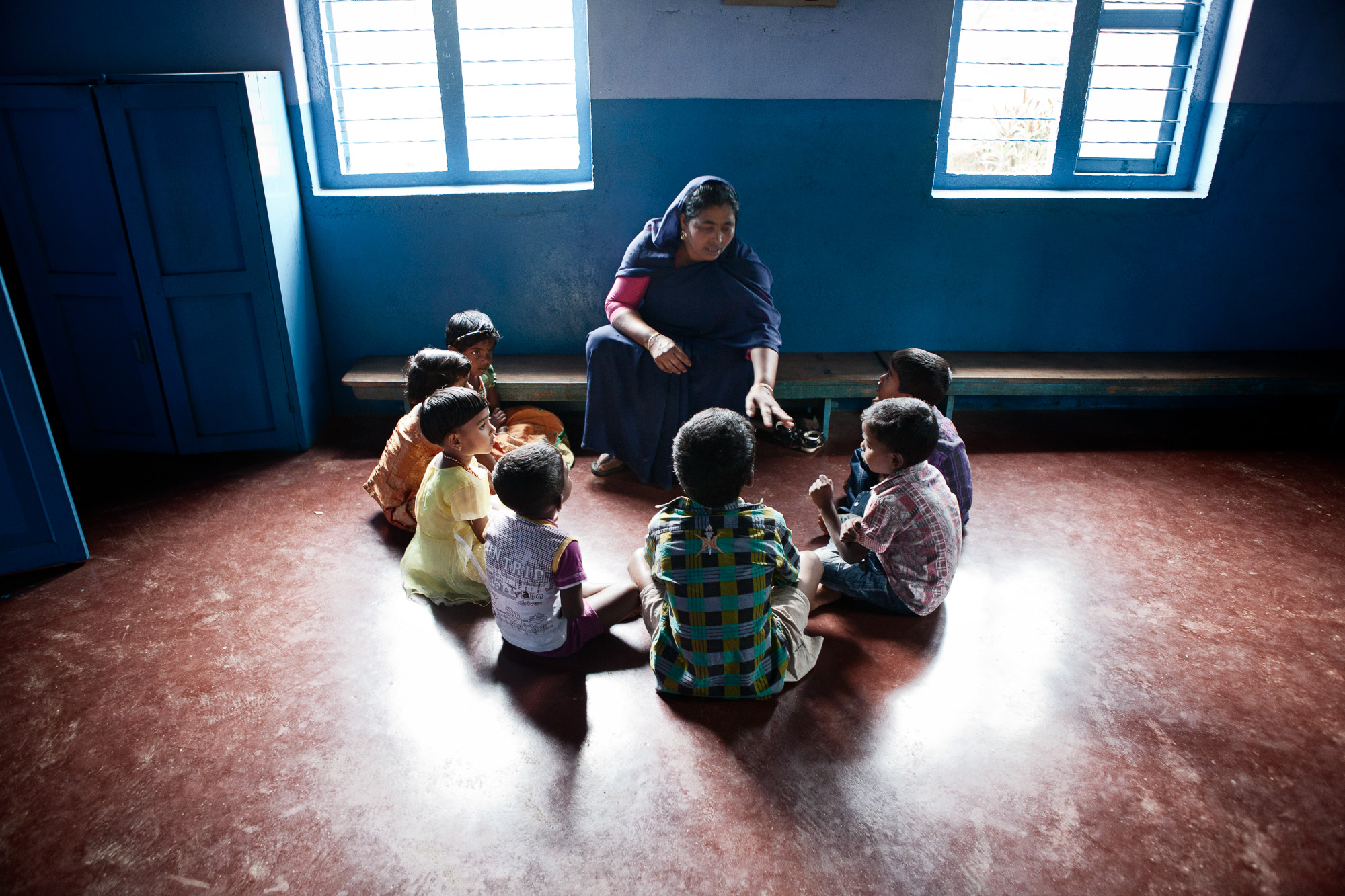 Sifantha, the teacher at the estate run nursery talks to the children at the start of the day.  All children of estate workers, regardless of their status, are entitled to free nursery care up the age of 6 before they progress to one of the local primary schools.   This measure is an estate run initiative which has helped the female workers immeasurably by caring for their children during their working hours.