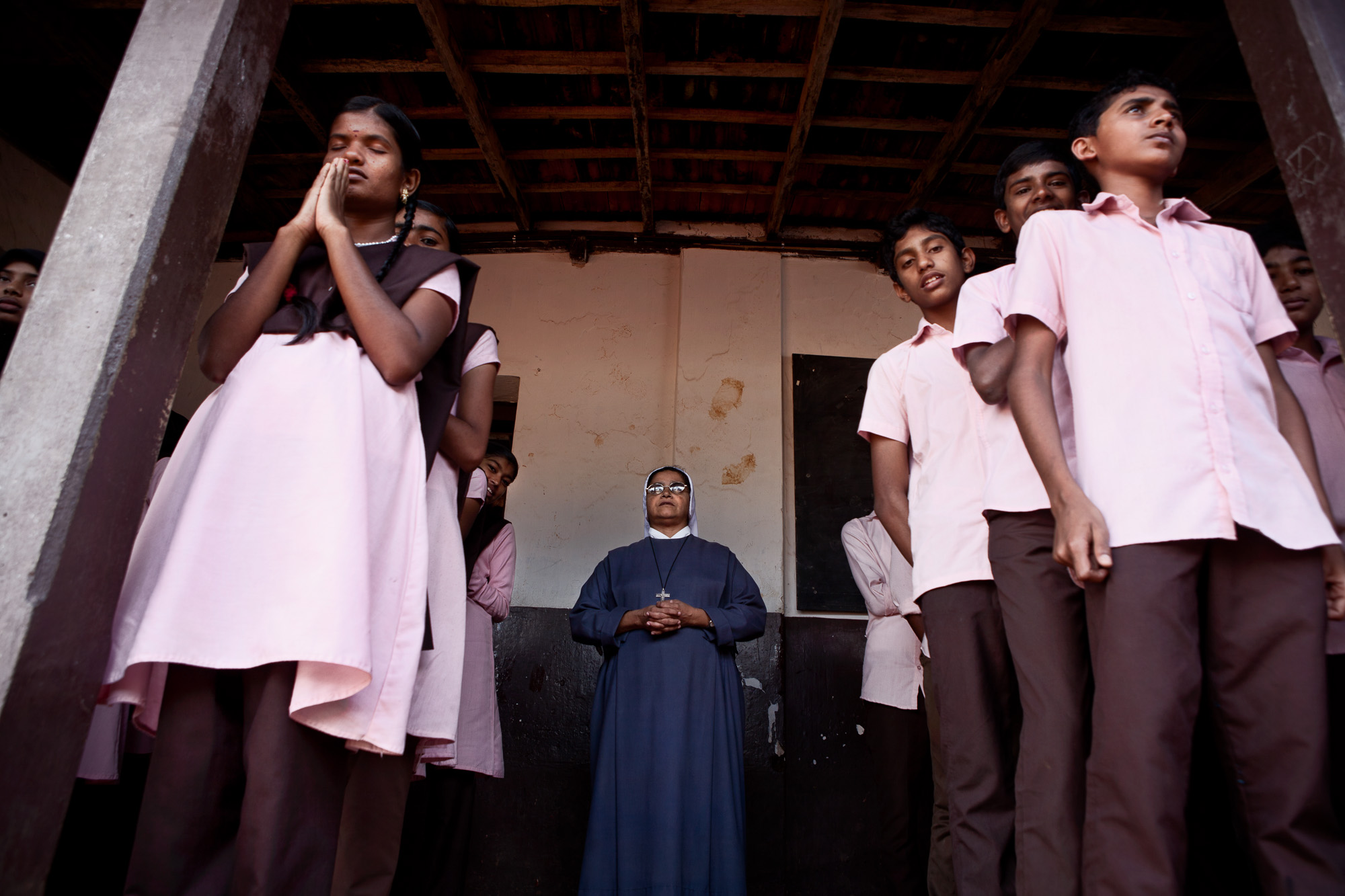 "Children of the 9th Standard class at the Roman Catholic High School, undertake the daily pledge for education during the morning assembly. The state of Kerala passed in 2002 ""The Right to Education Act"" where all children between the age of 6 years and 14 years must be in full time education.  Although the population is split 50% Hindu, 25% Christian and 25% Muslim most children, regardless of their religion are taught together."