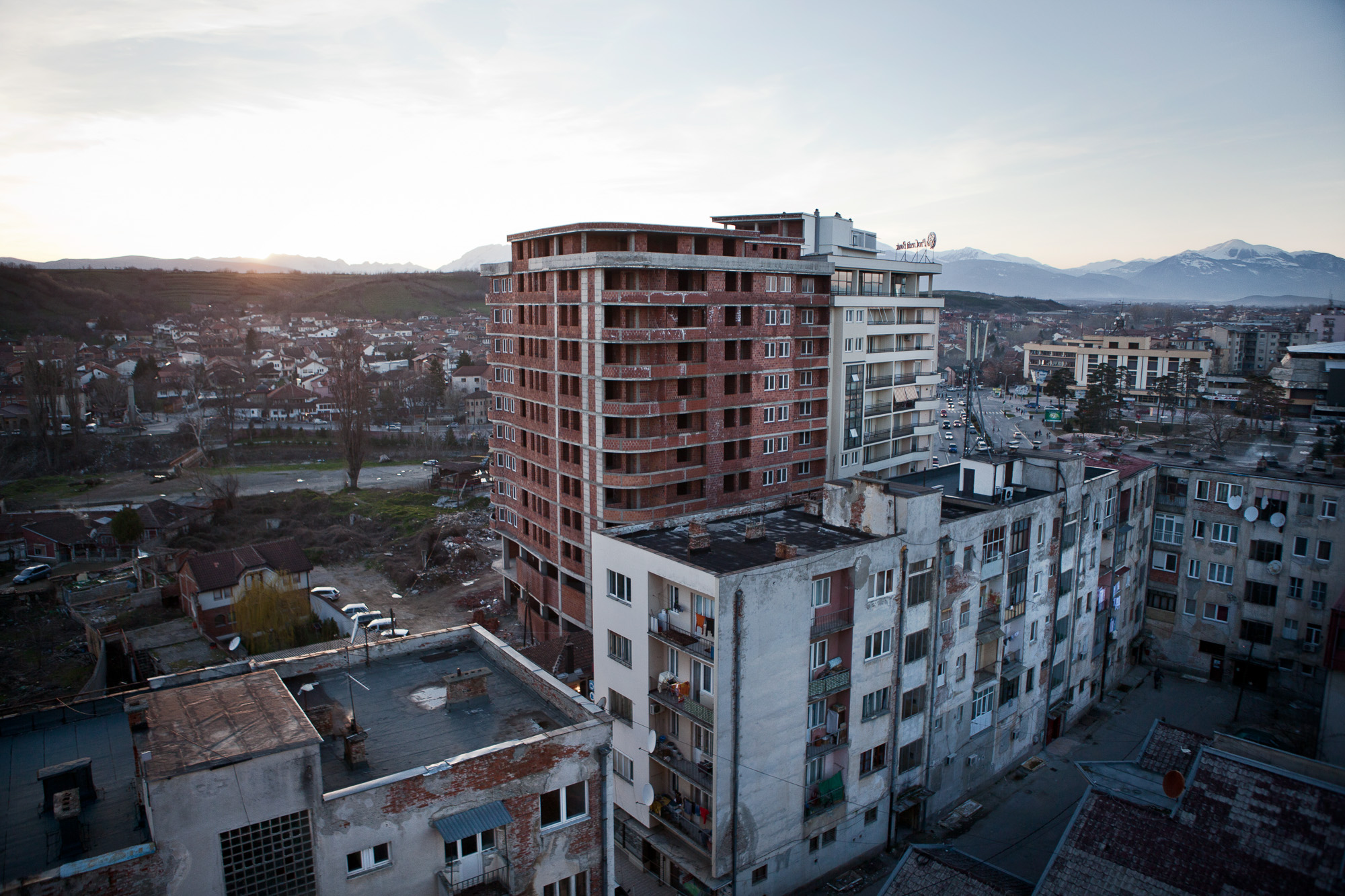 An uncompleted apartment block dominates the skyline of Gjakova city.  Built breaching planning permission, it highlights the problems that the country has faced in its recent past with corruption.   In order for Kosovo to be accepted as an EU member state, it is required to have certain levels of, infrastructure, employment and minimal corruption. However many of these stipulations are unachievable without foreign investment, which in turn is challenging without being an EU member, creating a revolving door syndrome.