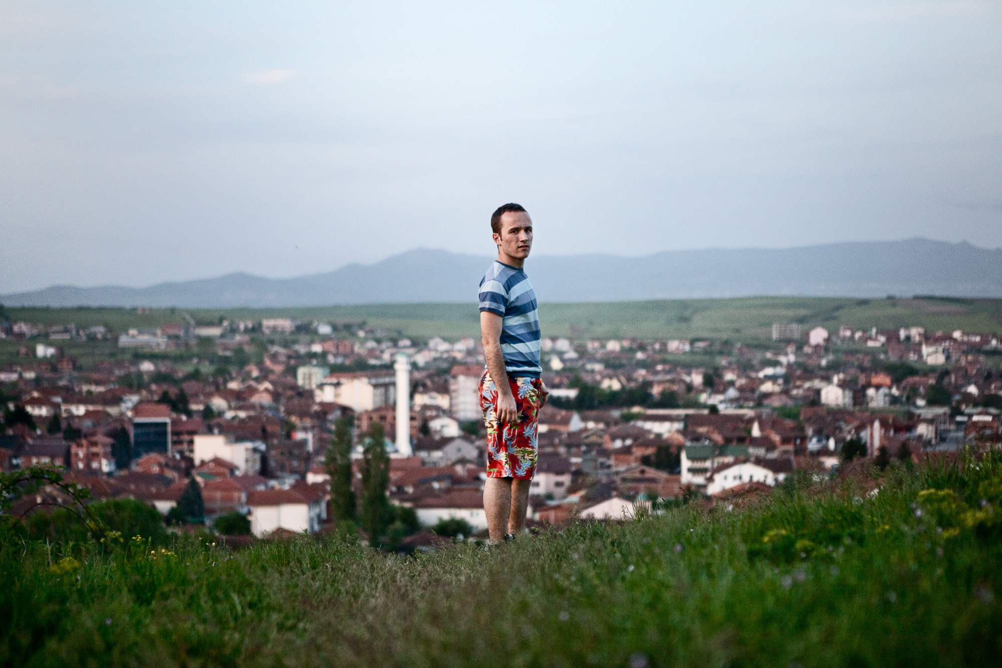 Overlooking the city of Gjakova,  Ilir Tullumi, knows that his immediate future does not lie here.  Fiercely proud of his nation and being a Kosovo Albanian, he wishes to make his mark elsewhere, but someday, when the country is more prosperous, return to his homeland. Already, 15% of Kosovo's GDP comes from the diaspora living and working abroad.