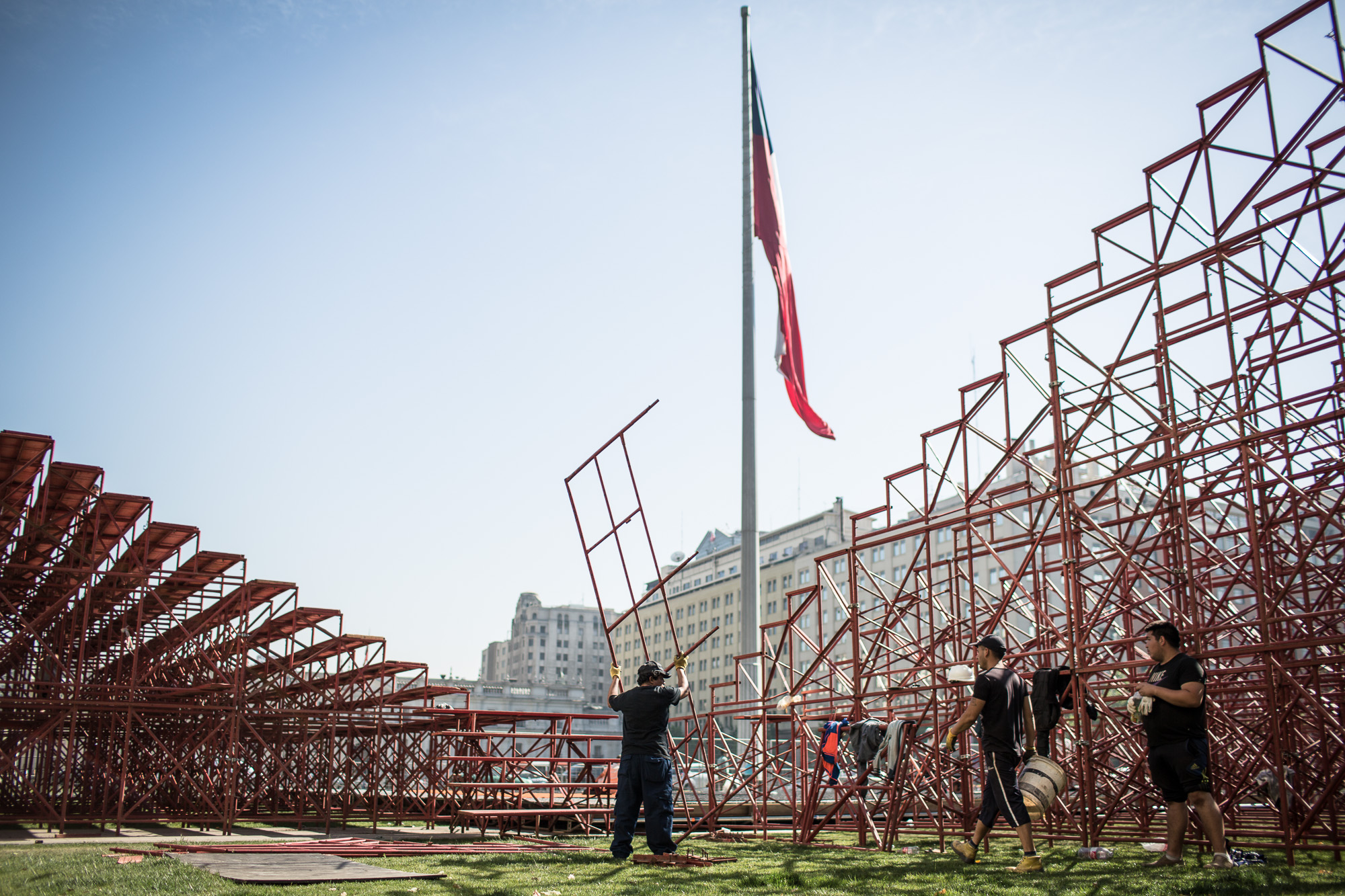 Workers race to construct the large viewing stands around one of the three pitches in Plaza de la Ciudadanía, central Santiago that will play host to the Homeless World Cup.  In only a couple of days, the stands will be packed with hundreds of fans, as the teams and event volunteers from around the world arrive in the bustling south American city.