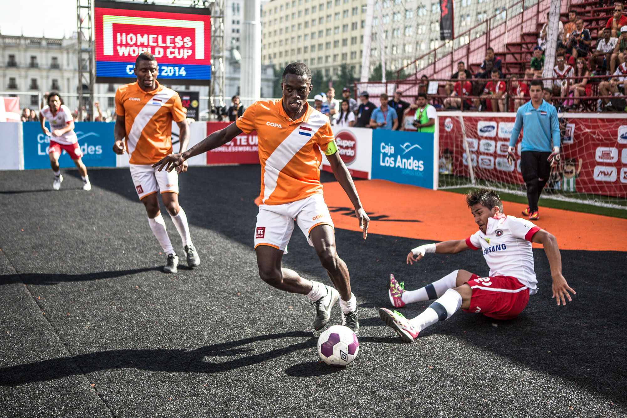 A player from team Netherlands tackles his Chilean opponent in the quarter finals of the tournament. Although these games are highly competitive with the players desperate to win the title, the ethos of the tournament is in the forefront of everyone's minds. If a foul is committed, the player will make sure to pick up his opponent, and make amends before play continues.  It is the indescribable camaraderie that adds to this competitions unique and inspiring nature. The commonality shared by all players shines through in all areas of life both on and off the pitch, with lack of animosity between even the most politically hostile countries.