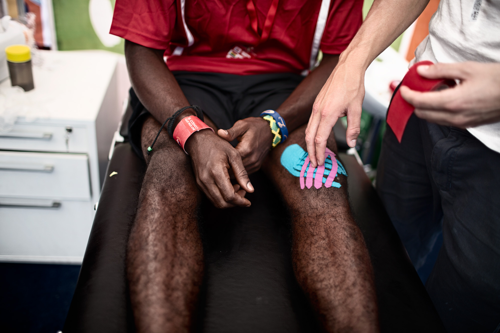 Mensah 18, sits in the medical area receiving care from a team physio before being taken to hospital with a torn ligament.  Upset not because of the extreme pain, but for the thought of letting his team down by not being able to play for the remainder of the competition. Most of the workforce providing the logistical, media, journalistic, and medial support are all volunteers. Many will have given up their time, sometimes using holiday leave, to travel across the world to work non-stop for this charitable organisation for the week, to ensure its undeniable success.