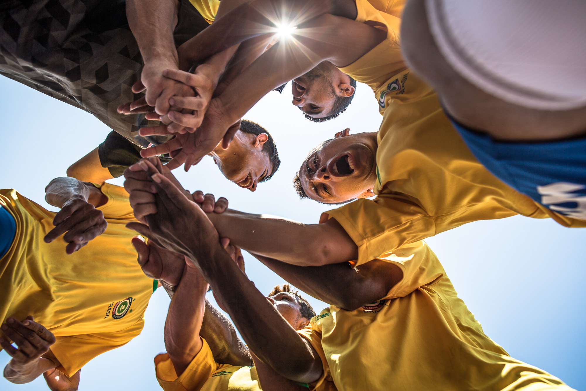 After the singing on national anthems, the Brazilian team huddle on the pitch right before kick-off.  The unseasonably hot weather during the tournament, meant that extra care had to be taken to hydrate the players.   As the competition is global in scale, the host nation changes each year.  This can sometimes raise logistical problems in certain cities, be it from low level corruption, petty theft, or security issues, all of which the organising team have to deal with and mitigate. However this has never been an insurmountable problem as is evidenced by the diverse range of nations visited by this tournament along with the many success stories from the individuals who pass through it.