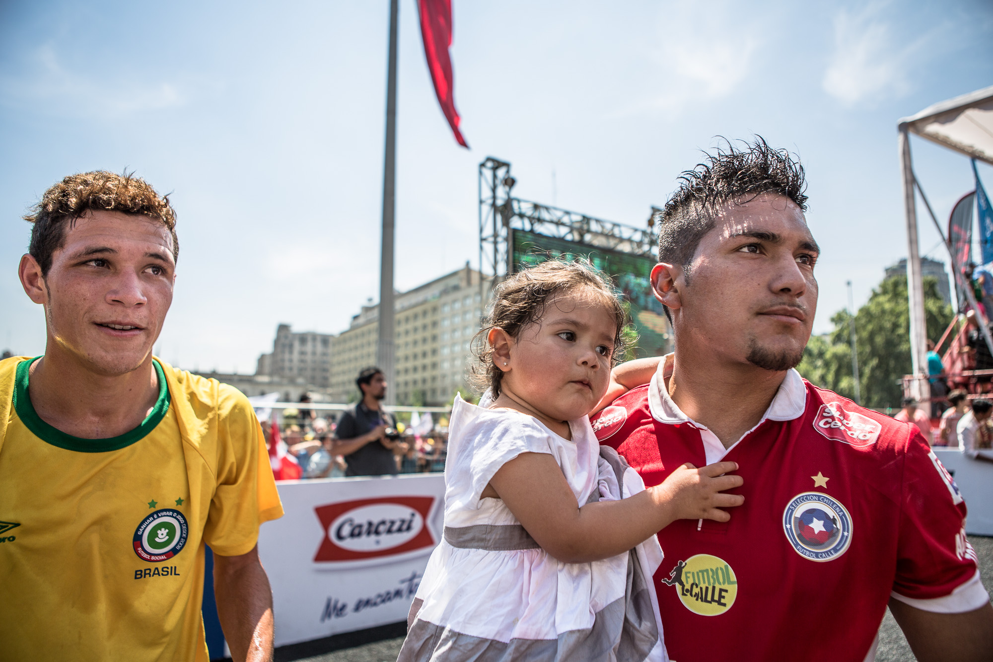 Players from both Chile and Brazil celebrate Chile's win in the final of the Homeless World Cup.  As the whistle was blown, this Chilean player grabbed his young daughter, to share in the celebrations of victory. The sense of empowerment on the faces of both the winning and losing team was overwhelming.