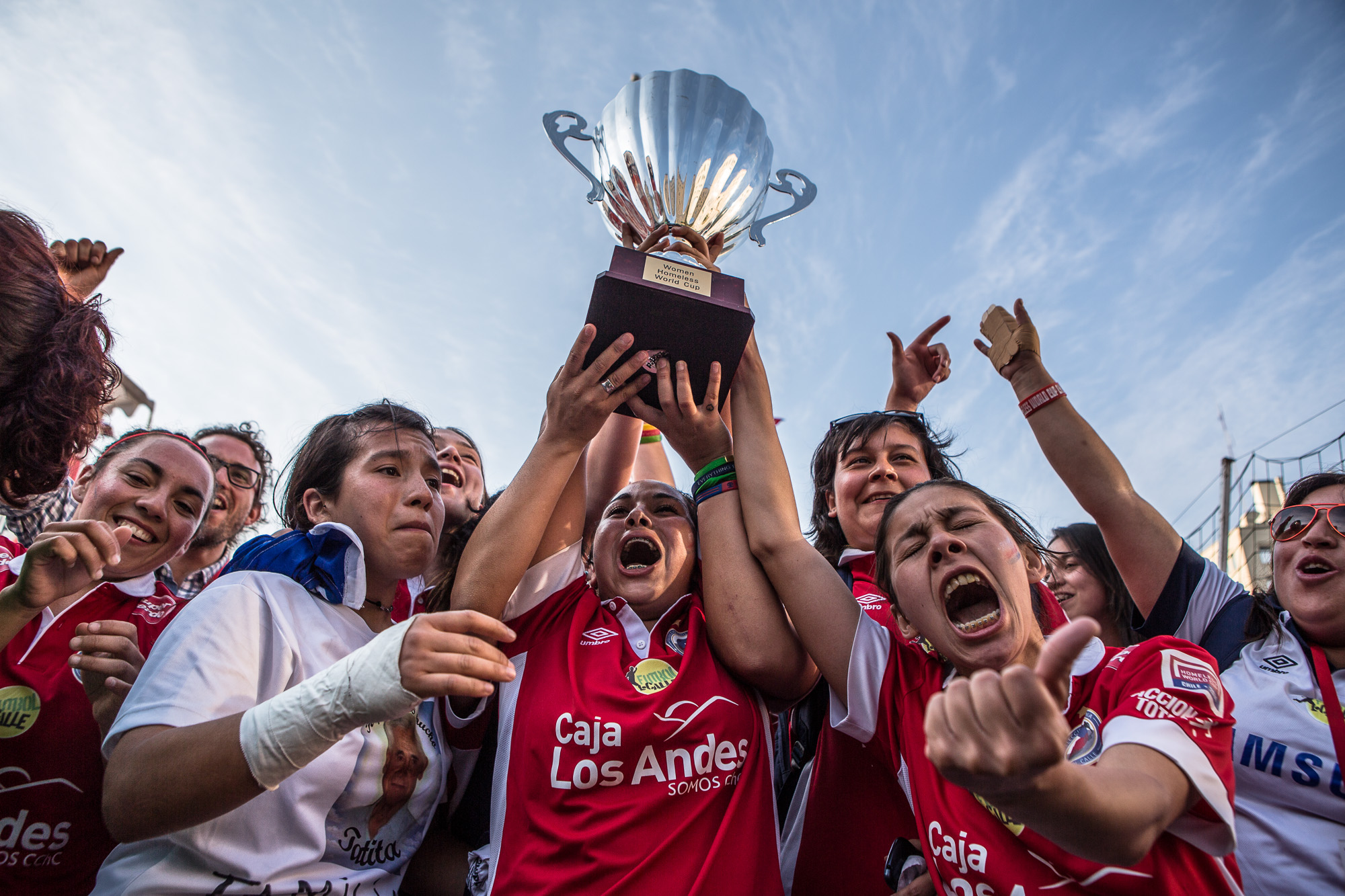 The Chilean woman's team celebrate winning the 12th annual Homeless World Cup in Santiago, Chile.  With mixed emotions from disbelief to sheer elation, the woman share their victory with the crowd and thousands of television viewers.  The impact to peoples lives goes far beyond the duration of the tournament, not just for the players, but the spectators, and volunteers also. Stereotypes of homelessness are crushed as anyone who talks to, comes into contact, or reads about the players are amazed by their personal stories, sometimes too difficult to even comprehend. However their fortitude and strength in the face of adversity, empowers others to achieve their aims and re-evaluate their own lives.