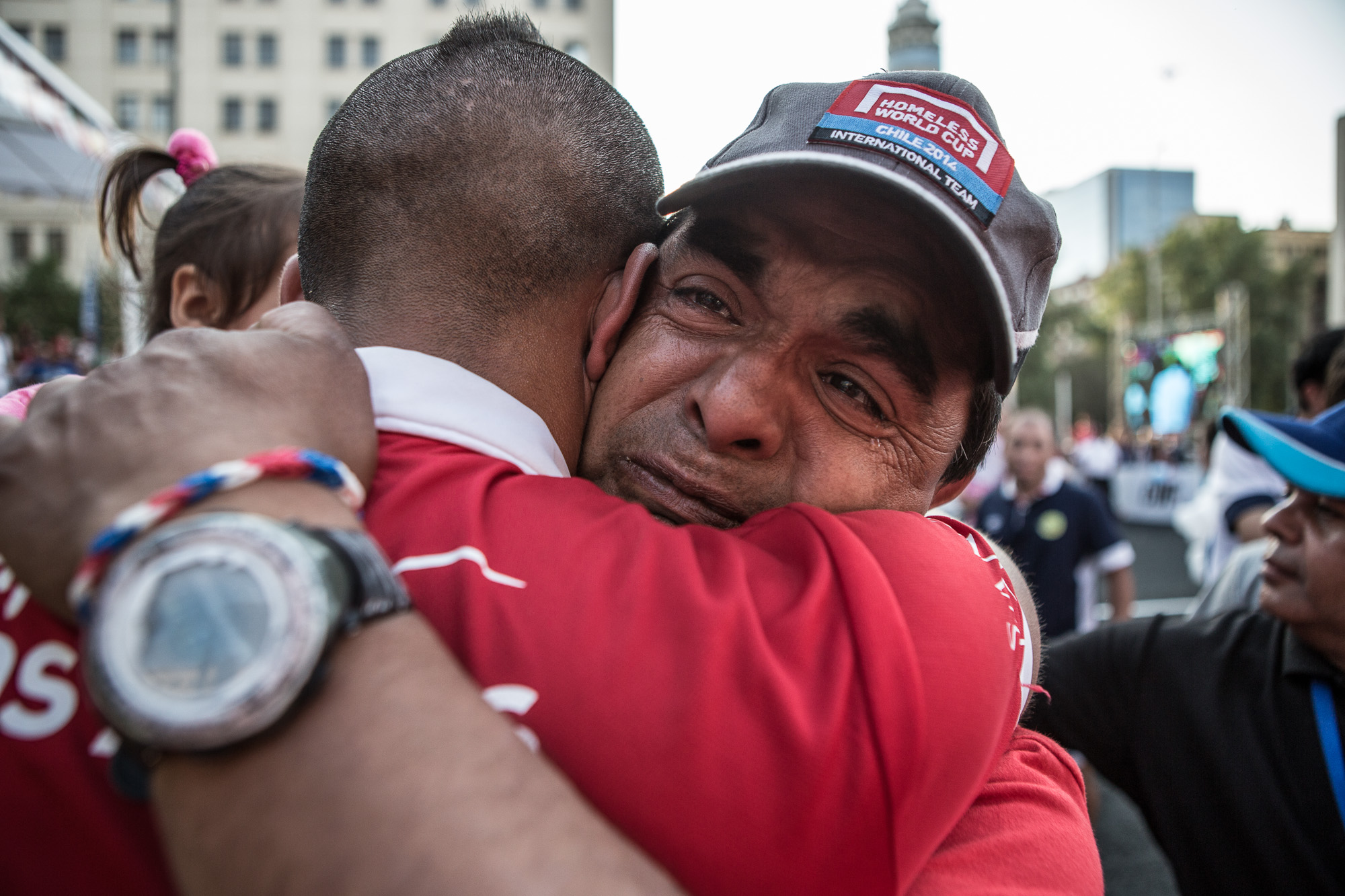 Luis a general Chilean handyman and local assistant for the event is overcome with emotion as he embraces the Chilean captain after their victory in the final. Being a fanatical street football fan, he travelled to Santiago purely in order to participate in the running of the event.  With next to no english skills, he endeared himself to everybody becoming one of the unofficial faces of the week long tournament.  With big ambitions for the future, he hopes to learn full English, and move to Europe to start his own street football organisation.