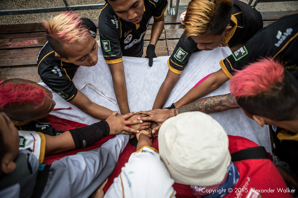 Team Indonesia praying before a match. The Homeless World Cup is a unique, pioneering social movement which uses football to inspire homeless people to change their own lives. Homeless World Cup 2015 is taking place in amsterdam from september 12th to September 19th. For more information, visit www.homelessworldcup.com