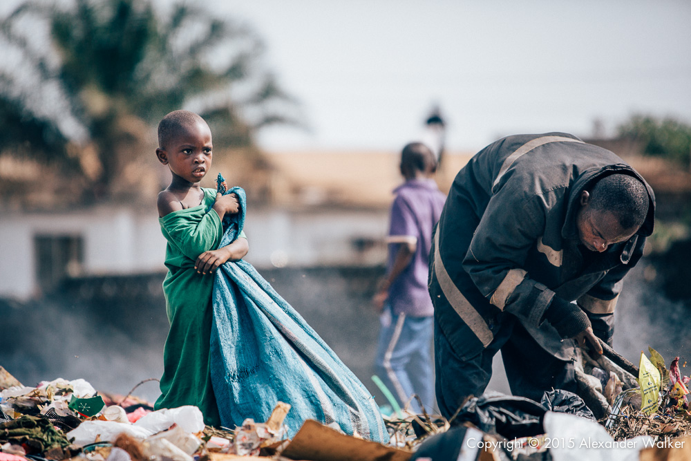 Osman (L) and his father Hassan (R) sort through rubbish on the rubbish dump in which they live. One of many in Freetown, Sierra Leone.   They are looking for anything valuable which can either be recycled,  or sold on.  Comic Relief awarded Childhope UK funds to work with local charity Street Child Sierra Leone to help more than one thousand children escape hazardous work, reunite with their families and get into education.  The project identifies the most vulnerable children on the streets and provide them with immediate practical support such as food, healthcare and clothing.