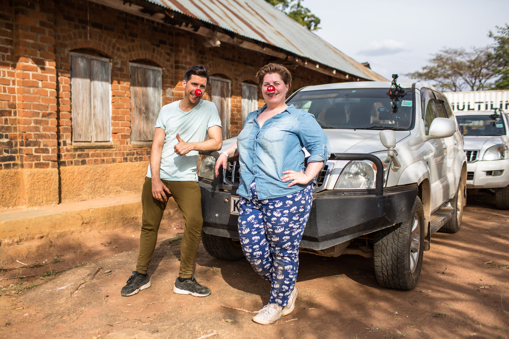 Russell Kane and Katy Brand, Red Nose Convoy drivers next to their vehicle.