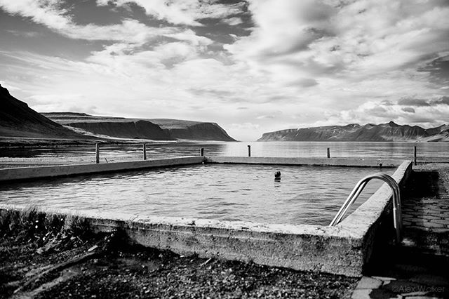 Sometimes you just need to relax,  and it helps when there's a thermal pool nearby! -  Reykjafjardarlaug Hot Pool - Iceland • • • • • #visiticeland #icelandscape #landscapelovers #thermalpool #westfjords #bw_lover #swimming #blacknwhite #bnwsouls #bnwmood #bnw_life #fjords #clouds #bnw_captures #mycanon #calming #nature #explore #instadaily #photojournalist #picoftheday #lifestyle #clarity #adventure #drama #adventure #outdoors #hiking #giant #mystopover