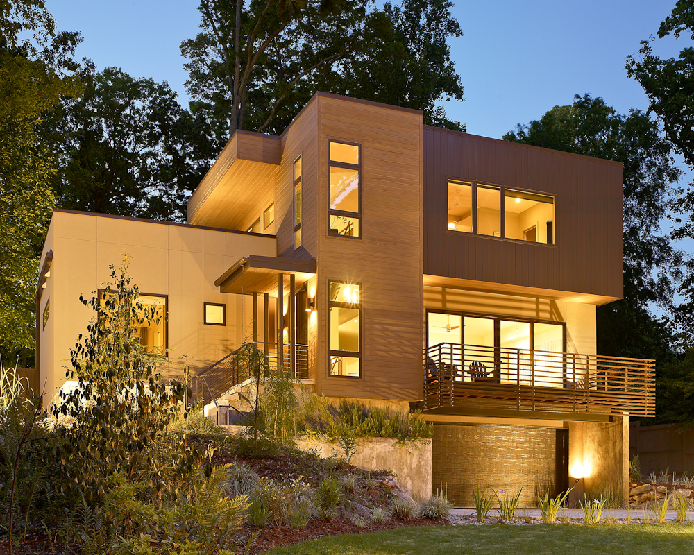 This LEED certified home is sited on a large sloping, wooded in-town lot. The 4 bedroom/ 3.5 bath home has geothermal heating & cooling, spray foam insulation and operable energy efficient windows located to enhance cross ventilation. A large 2nd floor terrace provides views to the street and rear yard, a courtyard expands the dining room outdoors. During the site development phase of this project, several large white oaks were harvested and milled for the interior flooring material. Other amenities include a wine cellar, an exercise room and a large screened porch that is designed to accommodate a future outdoor kitchen with a wood fired brick oven