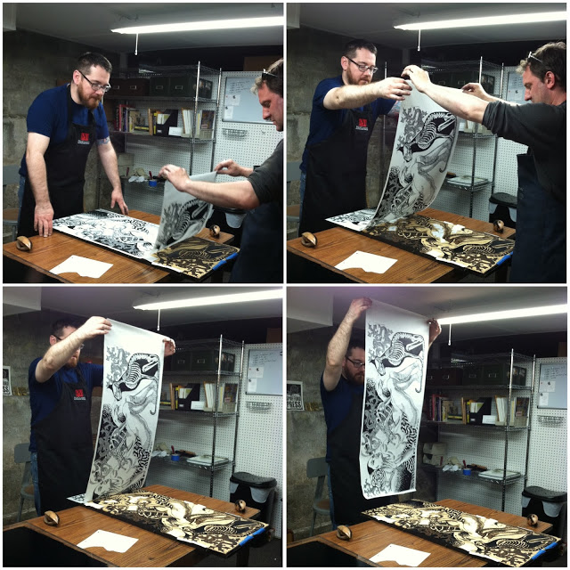 Here's the two-man process of pulling the final print off of the block!